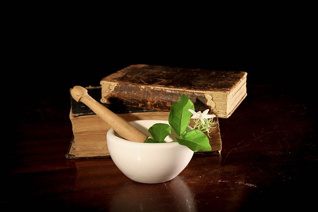 herbs in bowl with books