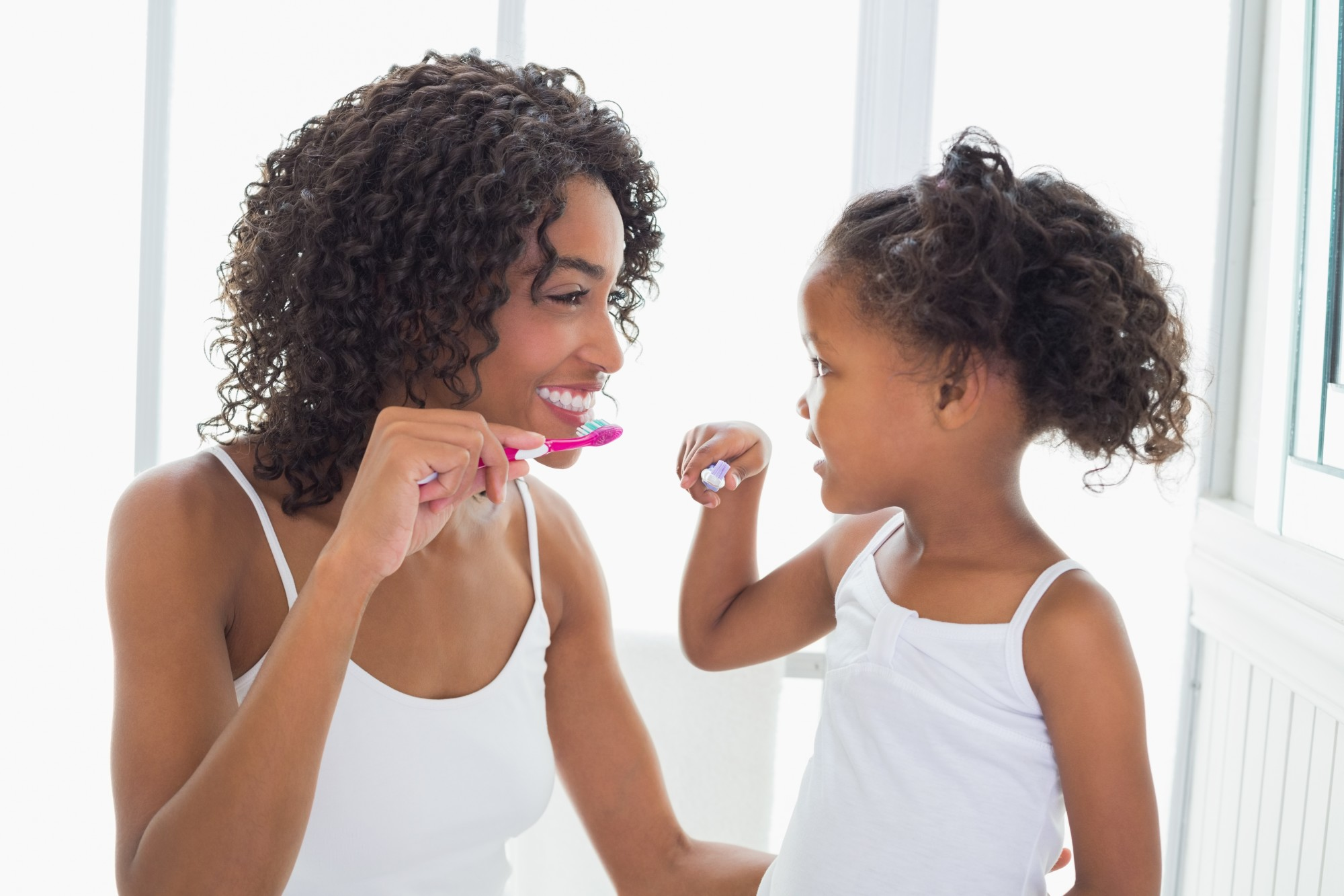 mom and child brushing teeth