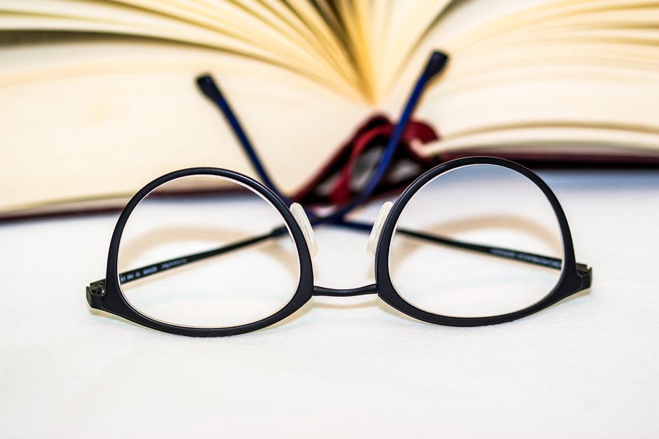 eye glasses and book