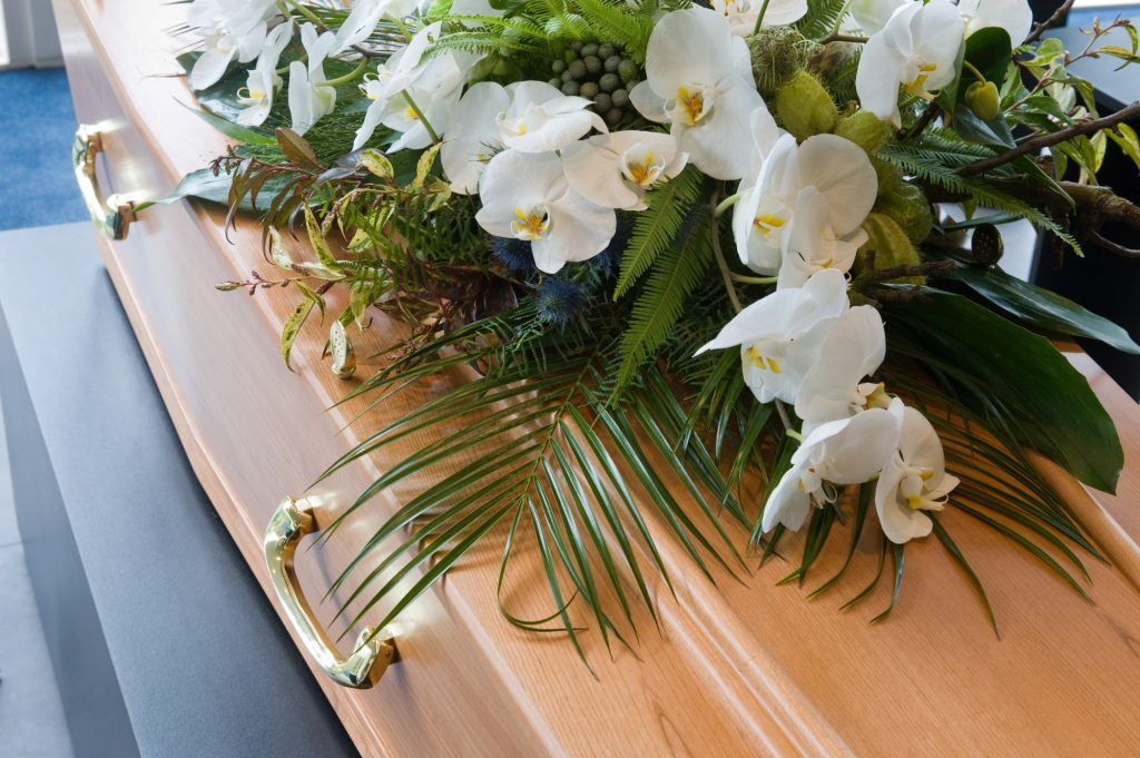 funeral casket with flowers