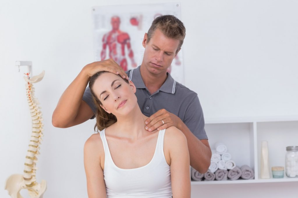 Chiropractor Conducting Procedure on a Woman