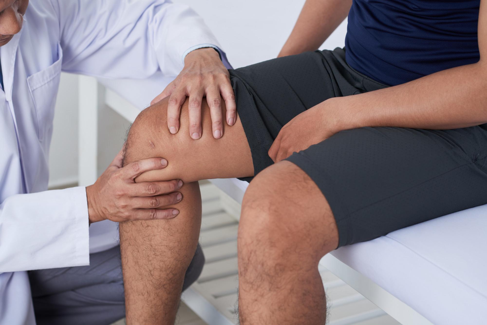 Orthopedic Surgeon Checking a Man's Knee