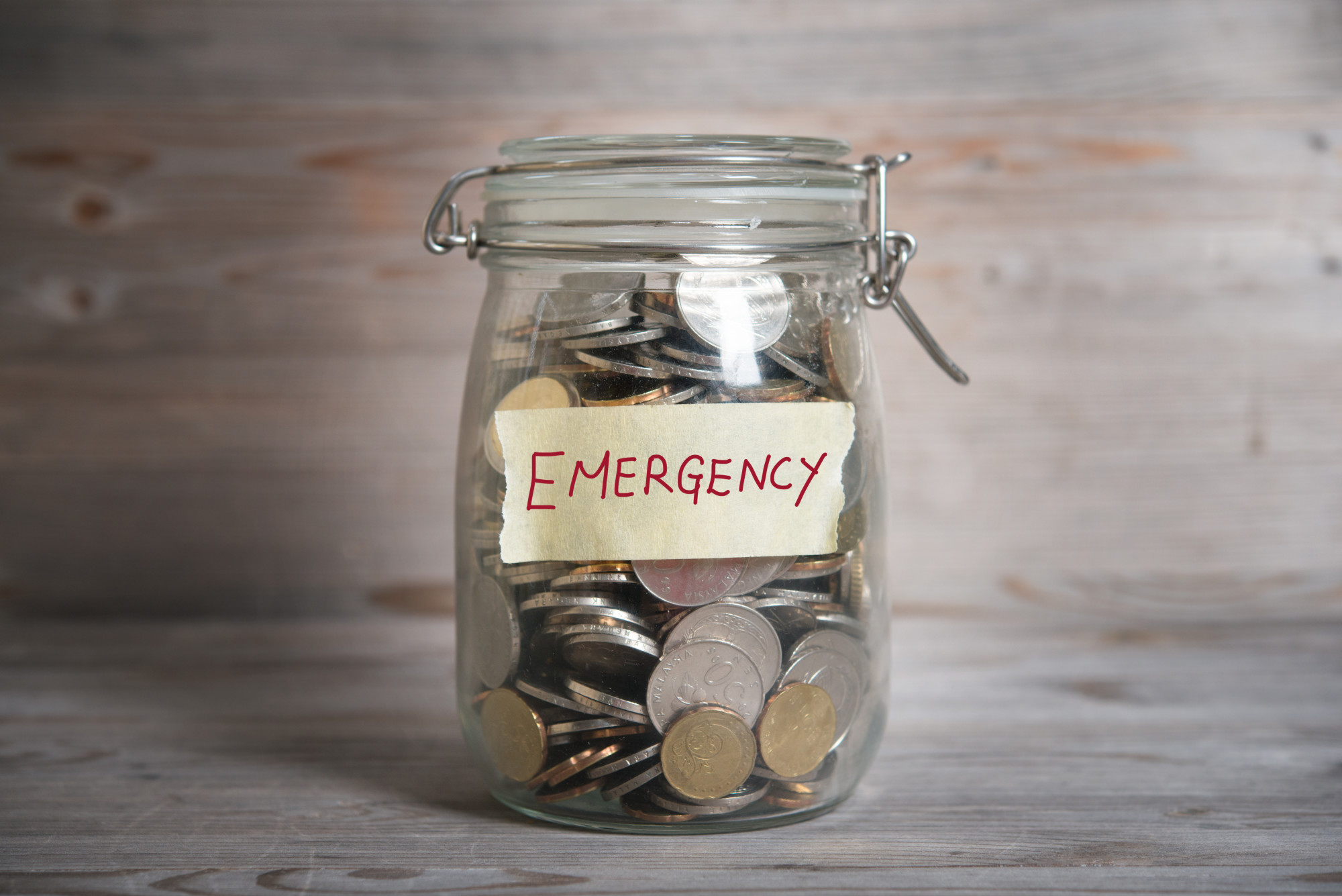 Coins on a Glass Jar as Emergency Fund