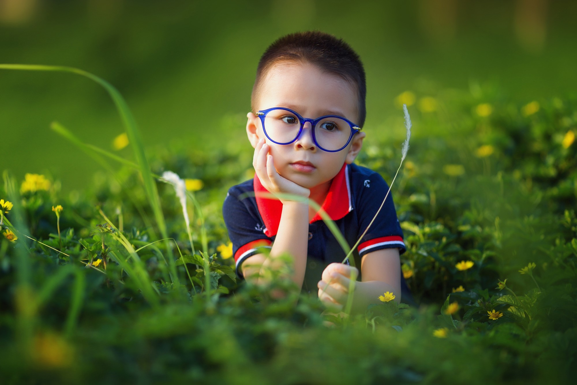 Smart Kid on a Grassy Field